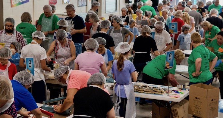 Volunteers prepare meals for Haiti